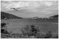 Floatplane approaching Charlotte Amalie harbor. Saint Thomas, US Virgin Islands ( black and white)