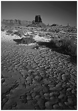 Clay pattern on floor and buttes in winter. Monument Valley Tribal Park, Navajo Nation, Arizona and Utah, USA ( black and white)