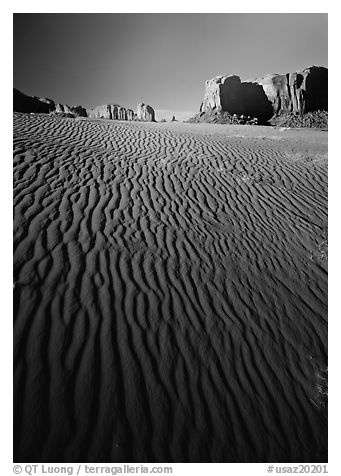 Ripples on sand dunes and mesas, late afternoon. Monument Valley Tribal Park, Navajo Nation, Arizona and Utah, USA (black and white)