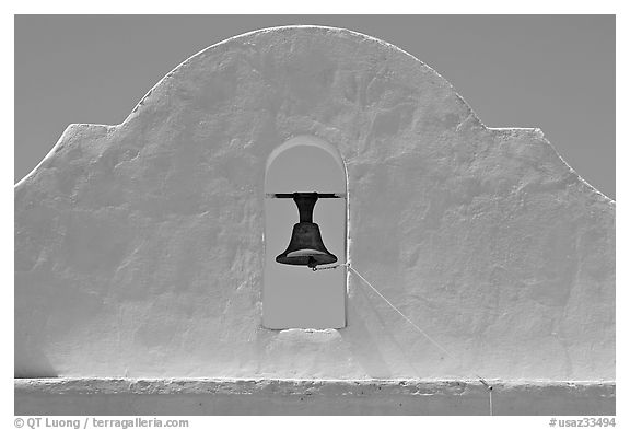 Bell and whitewashed wall, San Xavier del Bac Mission. Tucson, Arizona, USA (black and white)