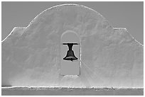 Bell and whitewashed wall, San Xavier del Bac Mission. Tucson, Arizona, USA ( black and white)