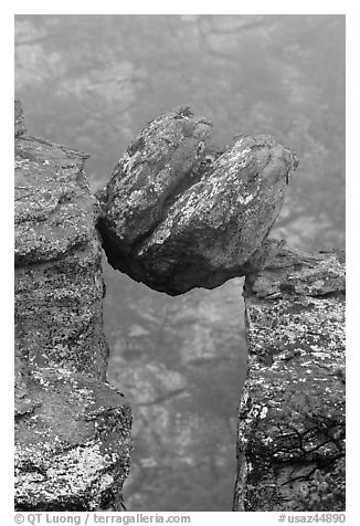 Spherical boulder stuck between pillars. Chiricahua National Monument, Arizona, USA (black and white)