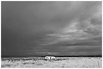 Trailer and storm sky. Arizona, USA (black and white)