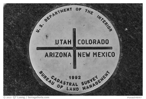 Marker at the exact Four Corners point. Four Corners Monument, Arizona, USA (black and white)