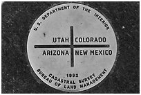 Marker at the exact Four Corners point. Four Corners Monument, Arizona, USA ( black and white)
