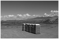 Portable toilets in desert. Four Corners Monument, Arizona, USA (black and white)