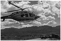 Helicopter at road accident site. Four Corners Monument, Arizona, USA (black and white)