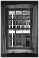 Looking out a window of Winsor Castle into the courtyard. Pipe Spring National Monument, Arizona, USA ( black and white)