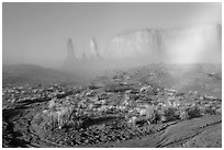 Three sisters, clearing fog, morning. Monument Valley Tribal Park, Navajo Nation, Arizona and Utah, USA (black and white)