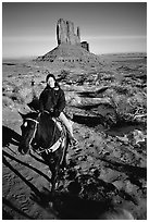 Horseback riding. Monument Valley Tribal Park, Navajo Nation, Arizona and Utah, USA ( black and white)