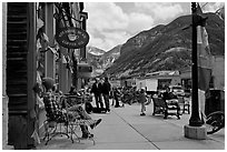 Men sitting on main street sidewalk. Telluride, Colorado, USA (black and white)