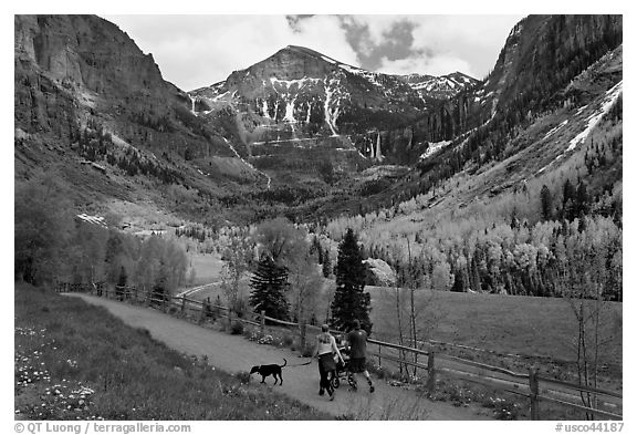 Family hiking on trail towards Bridalveil Falls in the spring. Telluride, Colorado, USA (black and white)