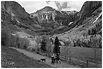 Family hiking on trail towards Bridalveil Falls in the spring. Telluride, Colorado, USA ( black and white)