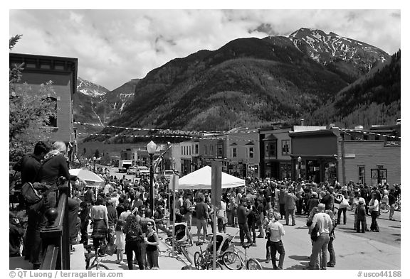 Crowds gather on main street during ice-cream social. Telluride, Colorado, USA