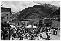 Crowds gather on main street during ice-cream social. Telluride, Colorado, USA (black and white)