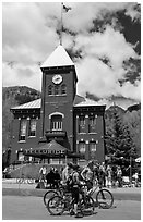 Mountain bikers in front of San Miguel County court house. Telluride, Colorado, USA ( black and white)