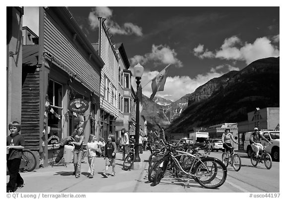 Children walking on main street past mountain bikes. Telluride, Colorado, USA (black and white)