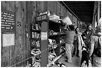 Items being exchanged at the free box. Telluride, Colorado, USA (black and white)