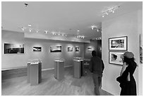 Visitors in art gallery. Telluride, Colorado, USA (black and white)
