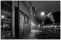 Street with parked bicycles and lamp by night. Telluride, Colorado, USA (black and white)