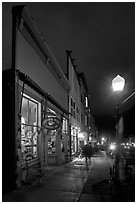 Coffee shop and sidewalk by night. Telluride, Colorado, USA (black and white)
