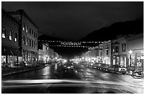 Colorado Street by night with Mountainfilm banner. Telluride, Colorado, USA (black and white)