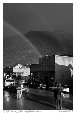 People watching double rainbow on main street. Telluride, Colorado, USA (black and white)
