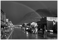 Double rainbow and dark sky over main street. Telluride, Colorado, USA (black and white)
