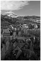 Mountain Village with newly leafed spring trees and snowy peaks. Telluride, Colorado, USA (black and white)