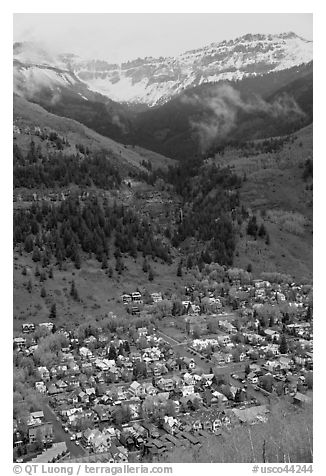 Town, waterfall, and snowy mountains in spring. Telluride, Colorado, USA (black and white)