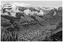 Box canyon surrounded by snowy mountains in spring. Telluride, Colorado, USA (black and white)