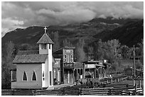 Western-style buildings and horses, Ridgeway. Colorado, USA (black and white)