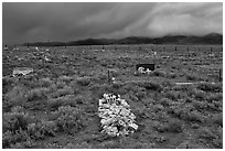 Grave made of loose stones, Villa Grove. Colorado, USA (black and white)