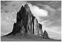 Shiprock with top embraced by cloud. Shiprock, New Mexico, USA (black and white)