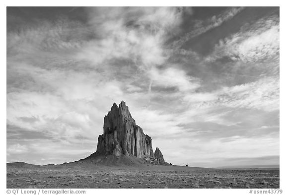 Shiprock volcanic plug raising above plain. Shiprock, New Mexico, USA (black and white)