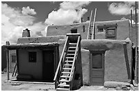 Multi-story pueblo houses with ladders. Taos, New Mexico, USA (black and white)