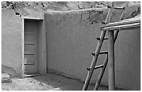 Blue door and ladder. Taos, New Mexico, USA (black and white)