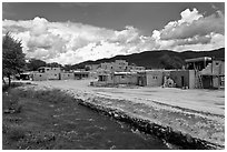 Rio Pueblo stream and pueblo village. Taos, New Mexico, USA ( black and white)