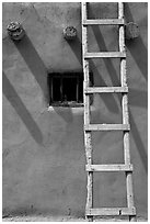Ladder, Vigas, and blue window. Taos, New Mexico, USA (black and white)