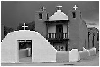San Geronimo church under dark sky. Taos, New Mexico, USA (black and white)