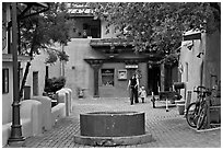 Pedestrian alley with woman and child. Taos, New Mexico, USA (black and white)