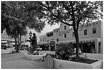 Plazza, statue, and hotel La Fonda. Taos, New Mexico, USA (black and white)