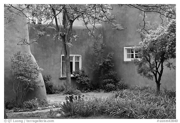 Garden and pueblo revival style building. Taos, New Mexico, USA (black and white)