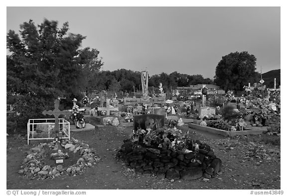 Tomb made of volcanic rocks in cemetery, Rancho de Taos. Taos, New Mexico, USA (black and white)
