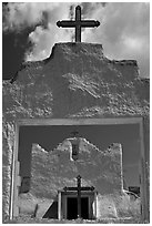 San Lorenzo Church seen through adobe walls, Picuris Pueblo. New Mexico, USA (black and white)