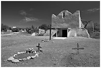 Graves and Picuris Church, Picuris Pueblo. New Mexico, USA (black and white)