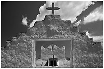 Adobe church framed by entrance in earthen wall, Picuris Pueblo. New Mexico, USA ( black and white)