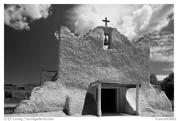 Facade of church covered with tightly compacted earth, clay, and straw, Picuris Pueblo. New Mexico, USA (black and white)
