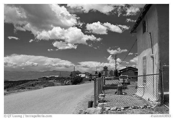 House and main street, Truchas. New Mexico, USA (black and white)