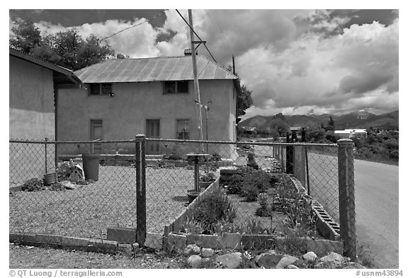 House with blue windows, Truchas. New Mexico, USA (black and white)